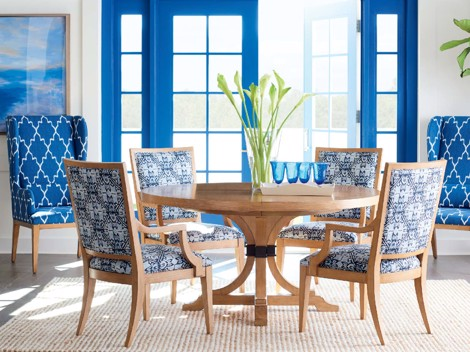 Blue upholstered print and wooden dining chairs with wooden dining table