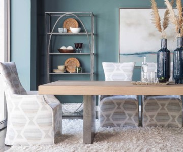 Metal and wooden dining table with upholstered print dining chair
