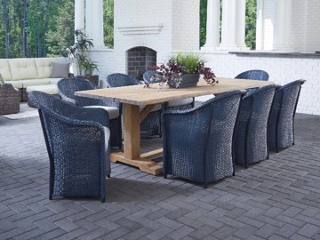 Blue woven dining chairs with natural wooden outdoor dining table