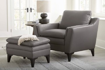 grey leather arm chair with grey leather foot stool