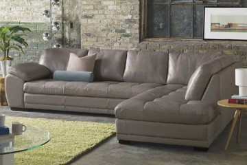 Grey leather sectional with loose back pillows