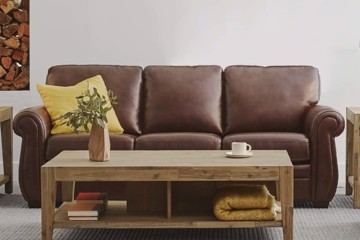 Brown leather sofa with rolled arm