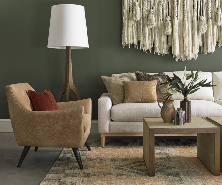 Precedent Upholstered sofa with tan arm chair and cocktail tables