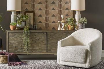 Precedent cream upholstered swivel arm chair