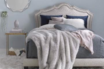 Precedent linen upholstered headboard and bed