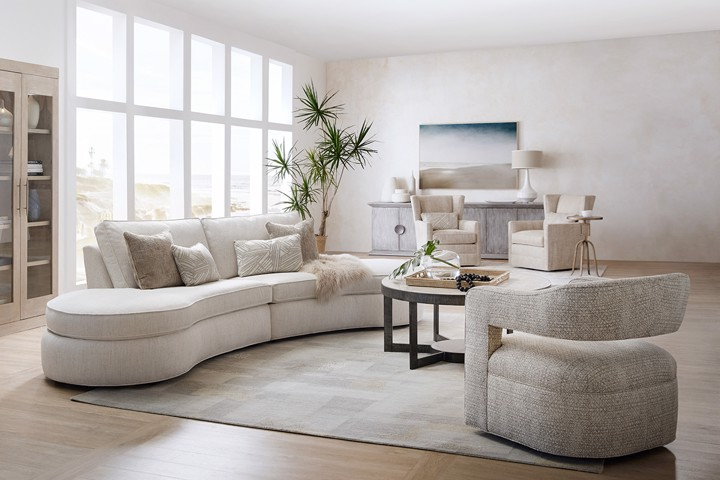 Curved Sectional with swivel chair in modern living room