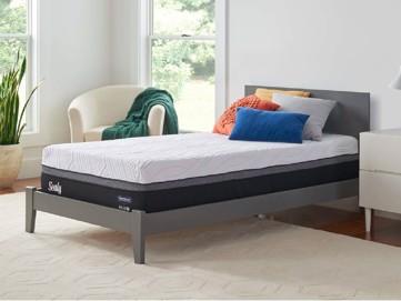 Mattress set on grey wooden bed