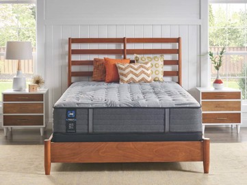 Mattress set on wooden bed with two nightstands