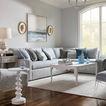 Theodore Alexander upholstered sofa with white end table and cocktail table