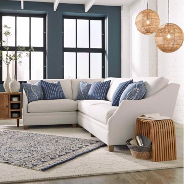 King Hickory casual white sectional and blue accent pillows