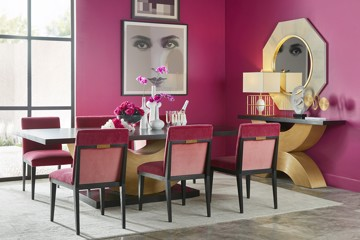 Pink upholstered dining chairs with gold accents