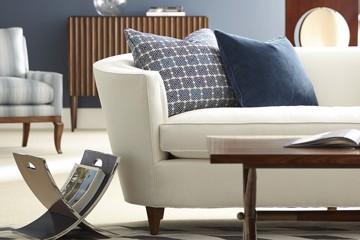 keno bros. collection sofa with blue accent pillows