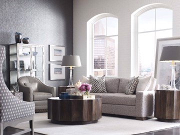 Upholstered sofa with wooden cocktail table and end table