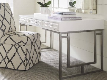 White vanity with metal legs and upholstered side chair
