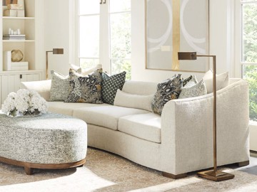 White upholstered sofa with upholstered ottoman