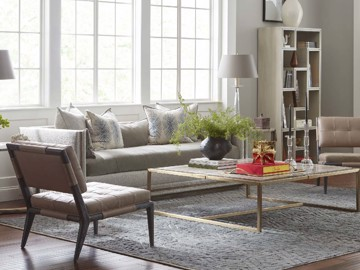 Upholstered Chesterfield sofa with leather side chairs