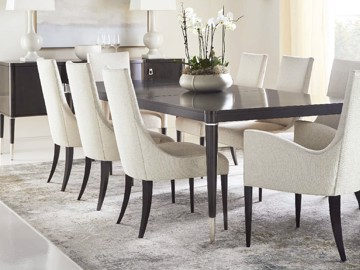 White upholstered dining chairs with dark legs