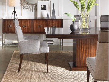 Pedestal base rectangular dining table with upholstered dining chair and wooden buffet