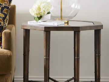 Wooden and glass end table with upholstered sofa