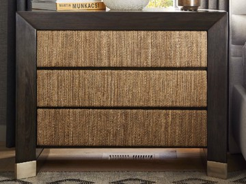 Dark wood three drawer nightstand with woven detail and brass feet